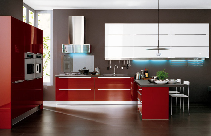 red cabinets and drawers, white cabinets, black counters, kitchen island decor, wooden floor