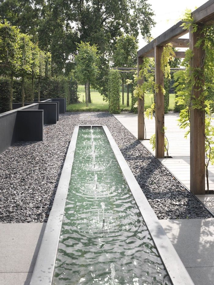 gravel pathway, small fountains, desert landscaping ideas, vines on a wooden structure, tall trees