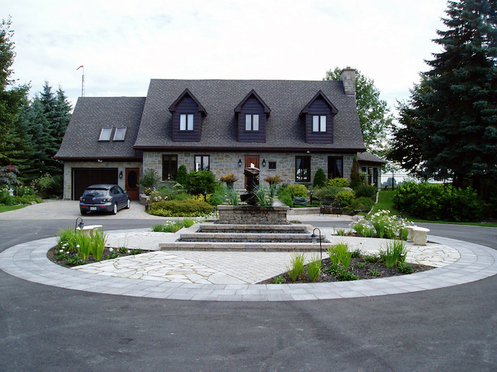 roundabout driveway, small fountain in the middle, desert landscaping ideas, small flower beds with lights