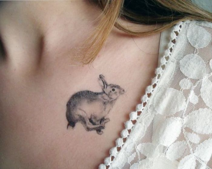 small running rabbit, tattoo on the shoulder, white top and straps, tattoos for girls on hand