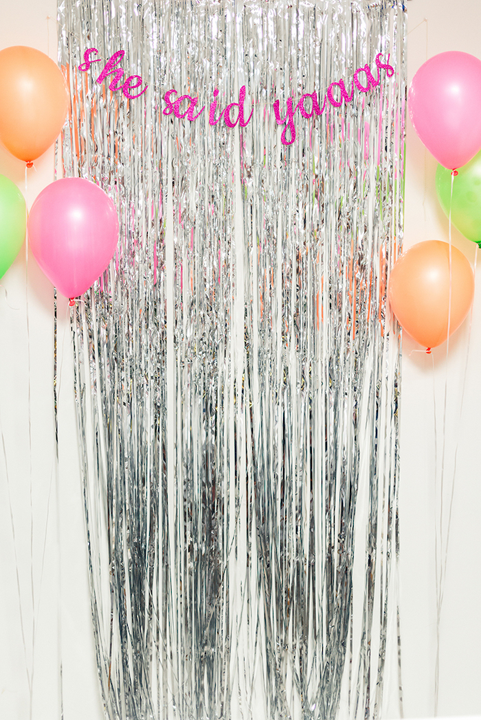 she said yaaas pink glitter sign, silver tassel, pink orange and green balloons, unique bachelorette party ideas
