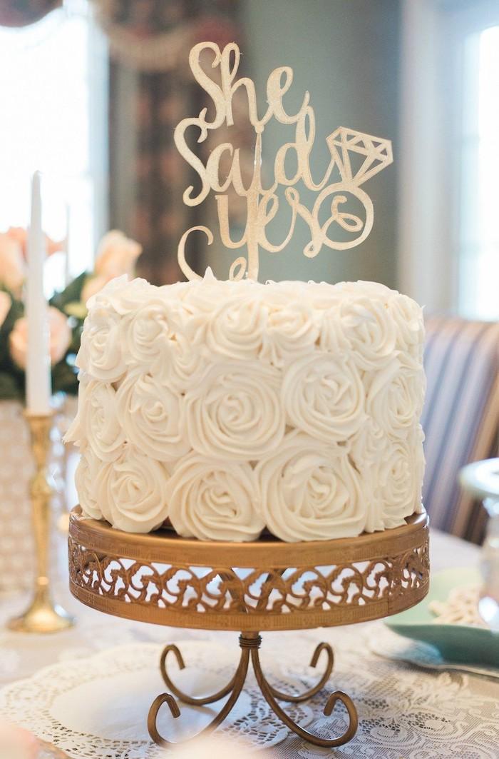 she said yes cake topper, white roses cake, golden cake stand, bachelorette shirt ideas