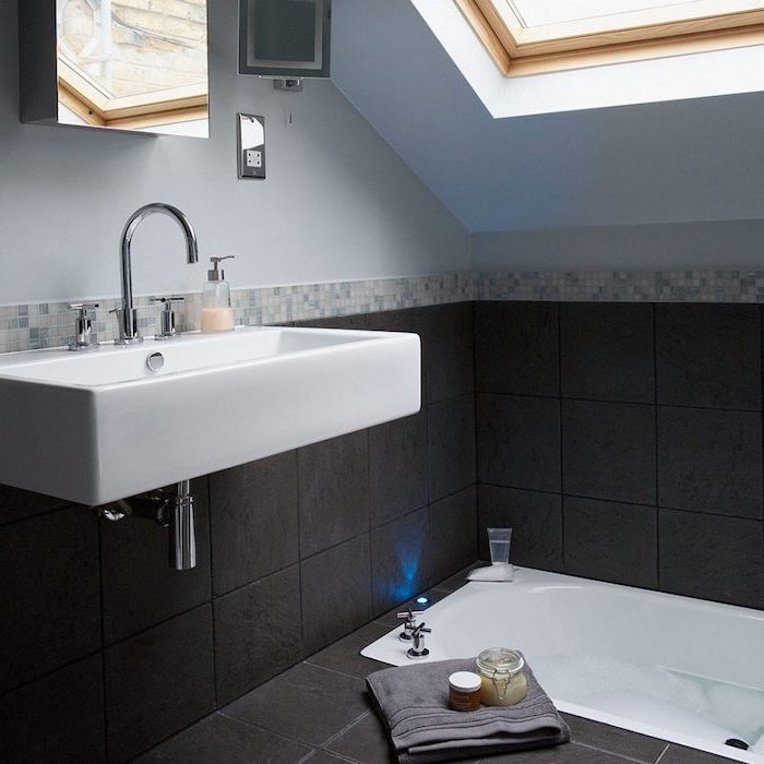 blue walls and black tiled floor, sinking bathtub, bathroom designs for small spaces, floating sink