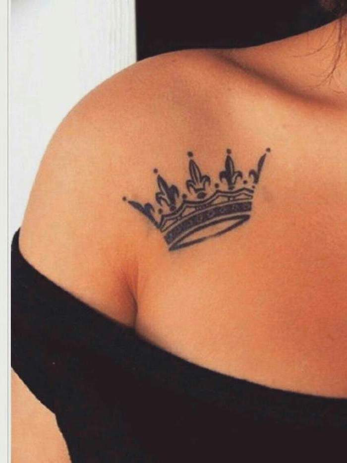 crown tattoo on the shoulder, tattoos for women, black top, black and white background