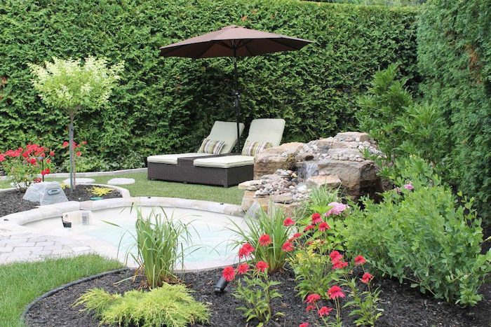 tall hedges, flower beds, front yard landscaping ideas with rocks, small trees and bushes