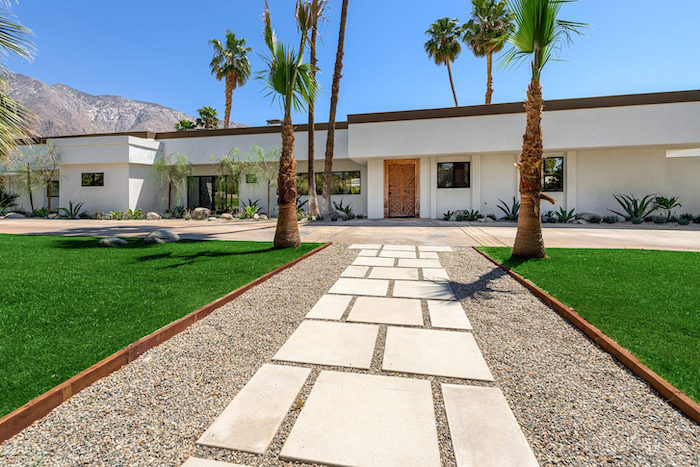 large grass patches, tall palm trees, hillside landscaping ideas, flower beds with bushes and small trees