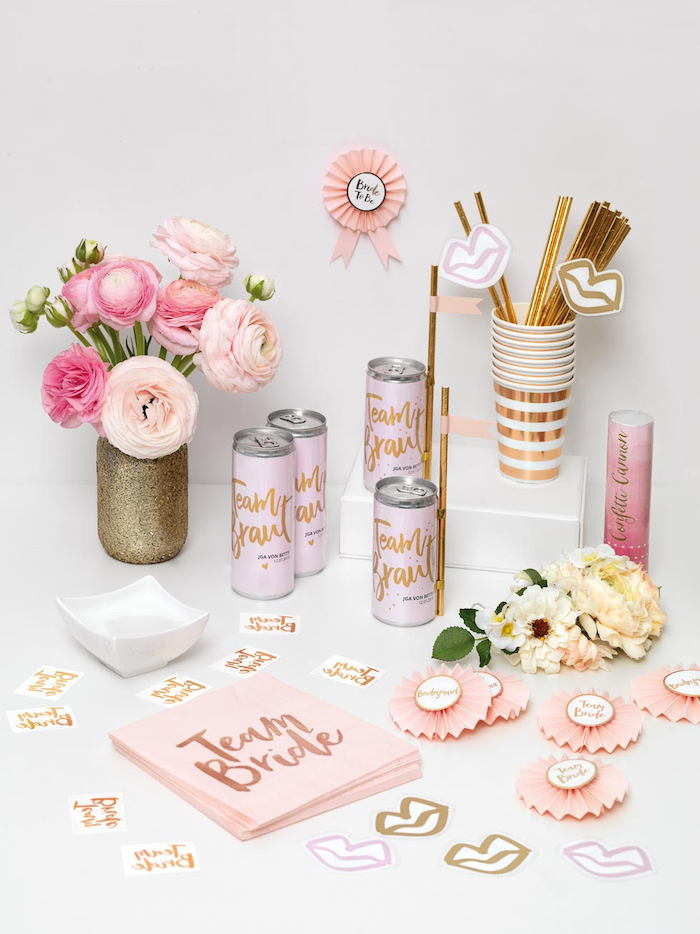 team bride napkins and cans, unique bachelorette party ideas, golden straws and paper cups, glitter vase with roses