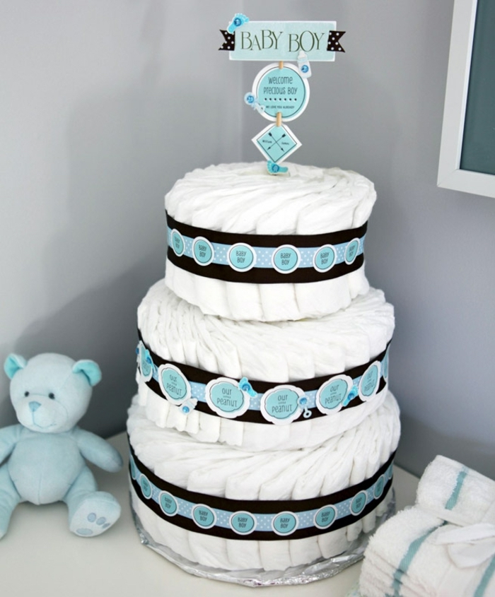 three tier diaper cake, baby boy cake topper, baby shower decoration ideas, black and blue ribbons