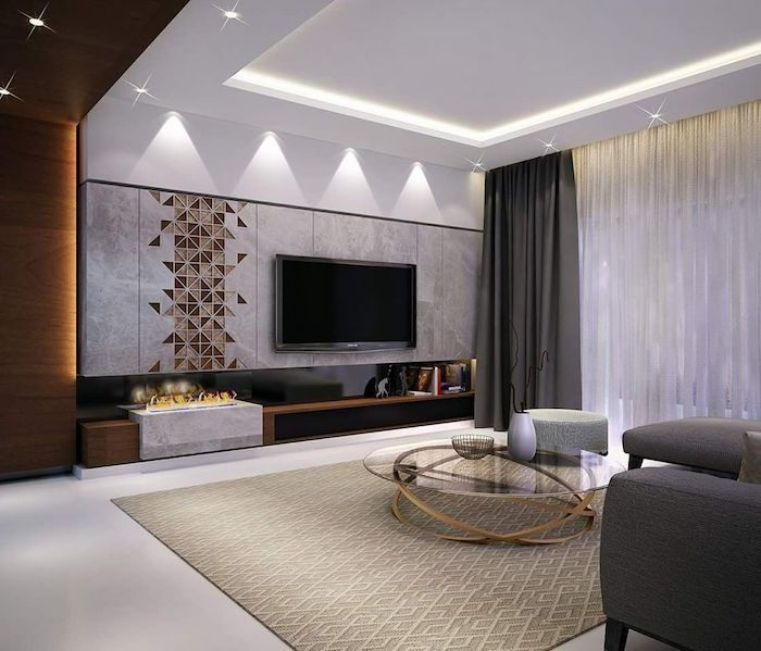 marble tiles and geometrical brown tiles on the wall, dark grey sofa, blue accent wall