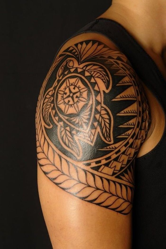tribal turtle on the shoulder, meaningful tattoo ideas, black top and background