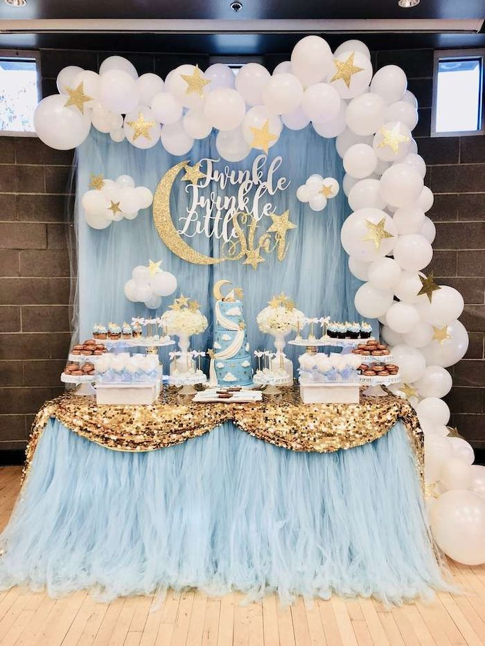 twinkle little star, white balloons and gold stars, blue tulle, cake and sweets on the table, baby boy baby shower themes