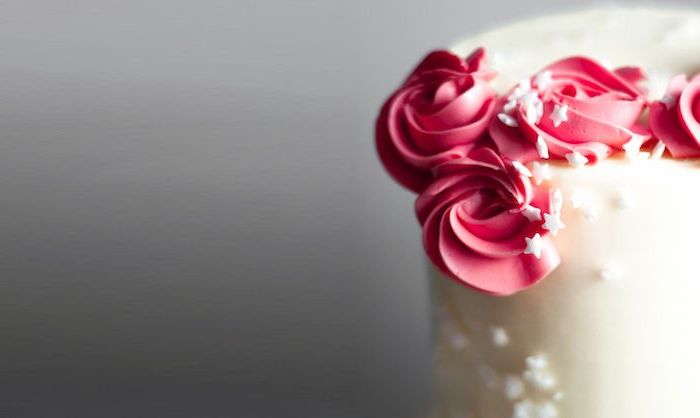 red roses, white star sprinkles, how to make a unicorn horn, white fondant, grey background