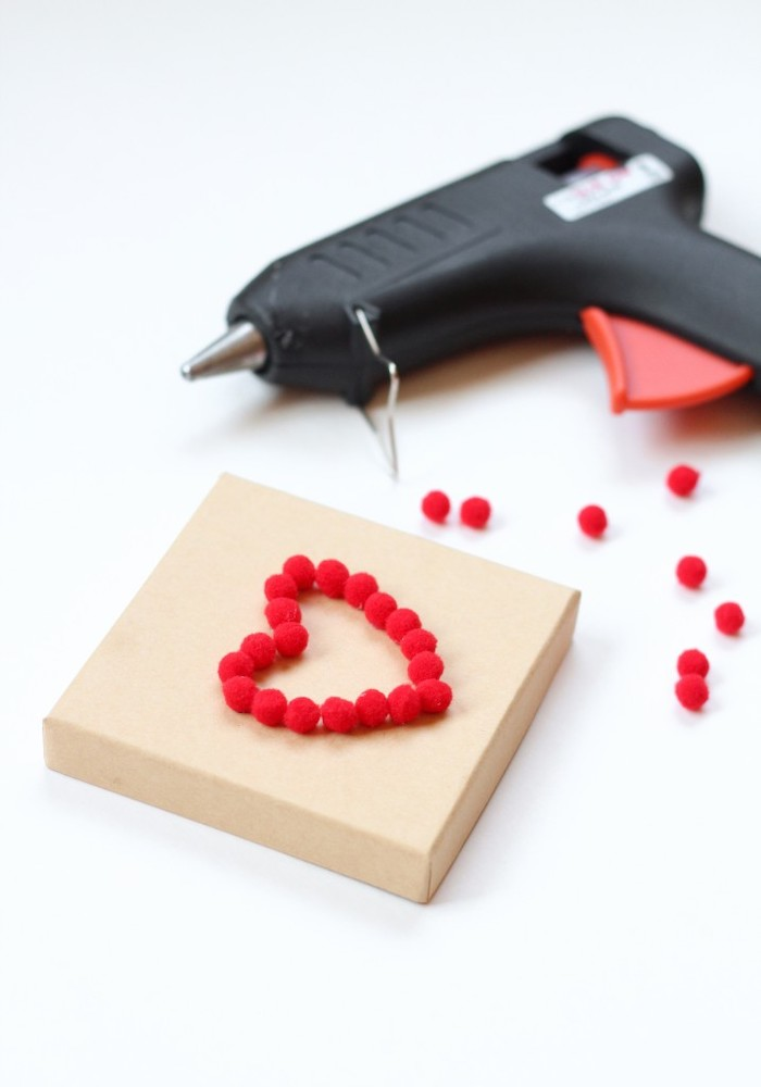 glue gun, heart shaped pom poms, cardboard box, gift basket ideas for boyfriend