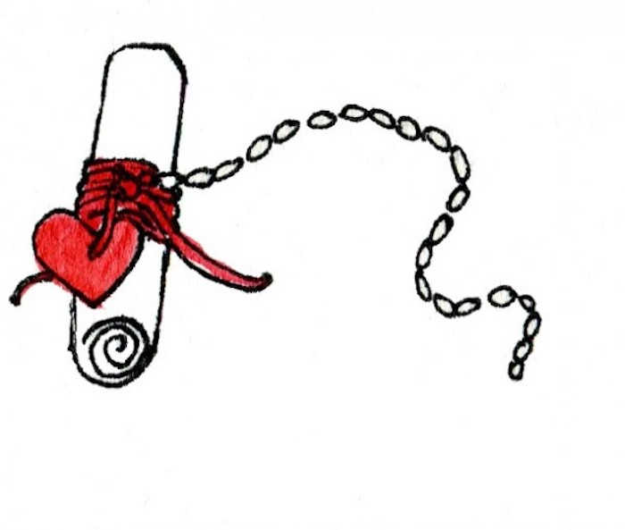 message written on a piece of paper, red heart on a chain, customised gifts for boyfriend