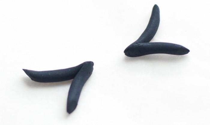 how to make a unicorn horn, white background, eyes shaped black fondant