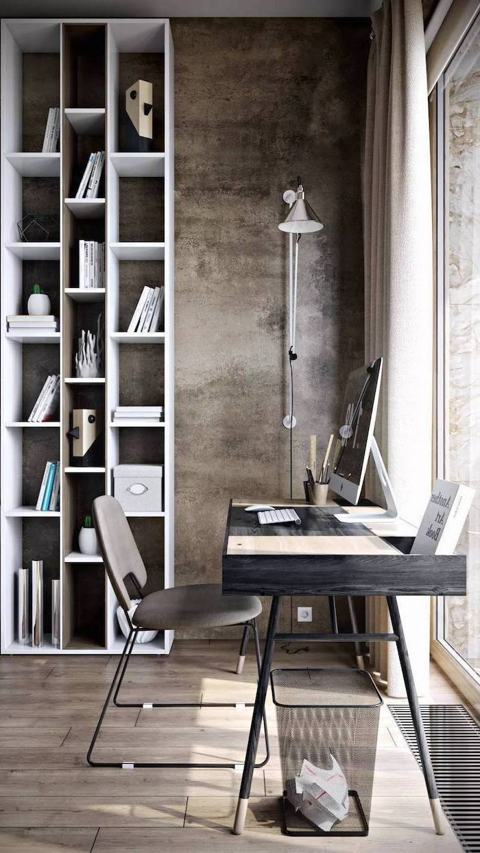 office design ideas, tall white bookcase, black wooden desk, small grey chair, lamp mounted on the wall