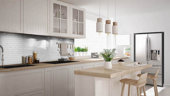 white brick backsplash, kitchen cabinets pictures, wooden counters and stools, white cabinets and drawers