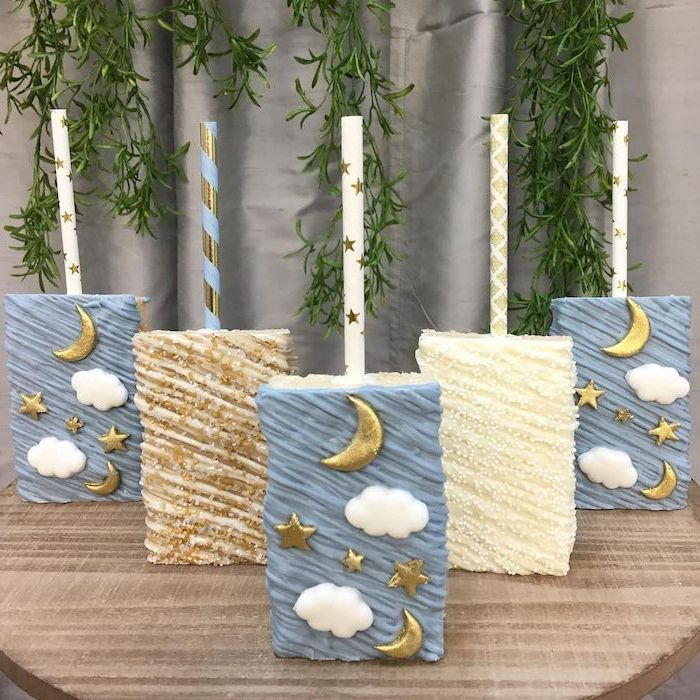 white brown and blue cake pops, gold stars and moon, sports themed baby shower, white clouds