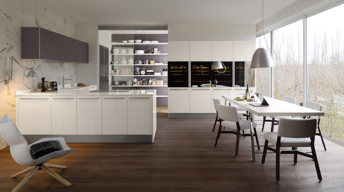 kitchen renovation, marble tiled wall, white cabinets and dining table, grey cabinets and chairs