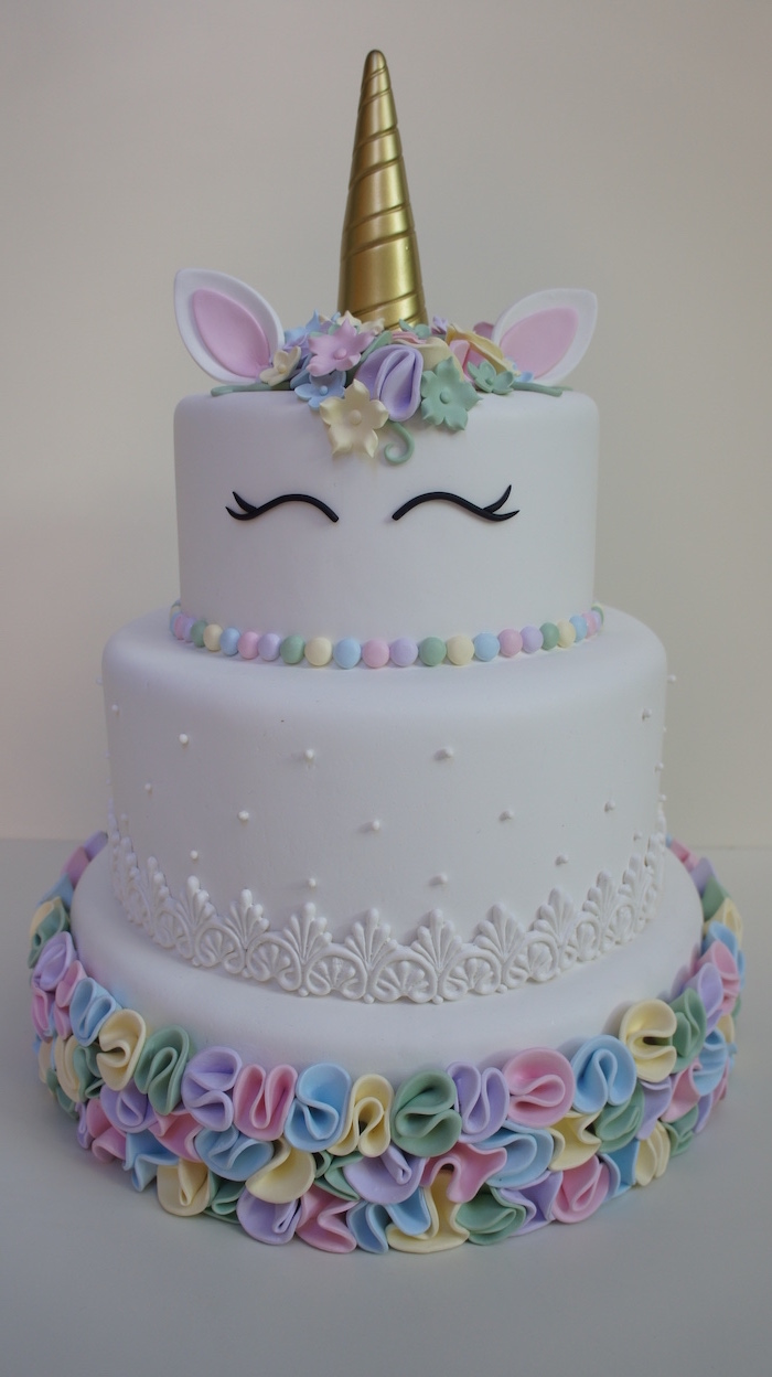 pink yellow green blue and purple roses on white fondant, unicorn cupcake cake, gold horn