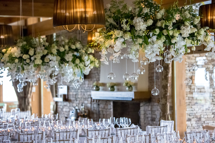 white roses hanging from the ceiling, white tulle on the chairs, wedding ideas for spring