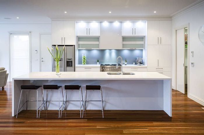 white kitchen island, kitchen designs photo gallery, white cabinets and drawers, black stools
