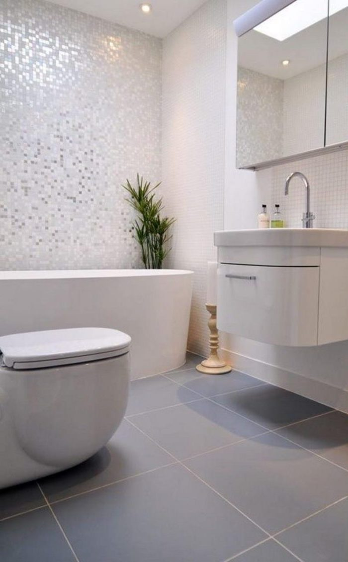 white mosaic tiled wall, blue tiled floor, bathroom ideas for small bathrooms, floating white cabinet and sink