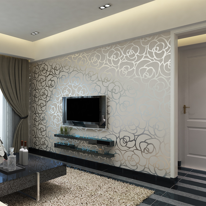 white and silver floral wallpaper, wallpaper accent wall, grey and black striped floor, black coffee table