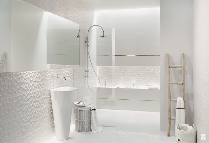 white 3d tiled walls, white cabinets and oval sink, modern bathroom design, large window