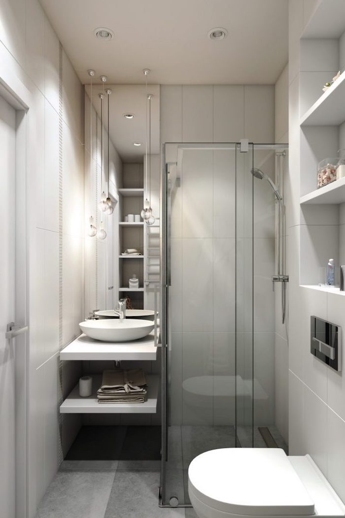 grey tiled walls and floor, bathroom wall ideas, glass shower door, large mirror, floating wooden shelves