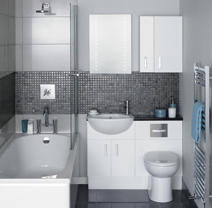 grey mosaic tiled walls, black tiled floor, bathroom wall ideas, white cabinets bathtub and toilet bowl