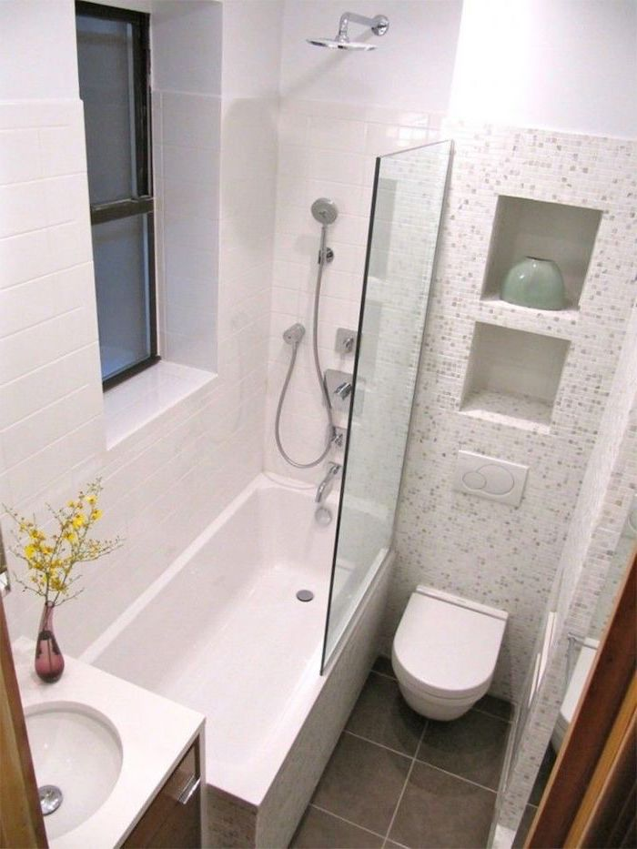 white mosaic tiled walls, brown tiled floor, bathroom wall ideas, glass shower door, wooden cabinets