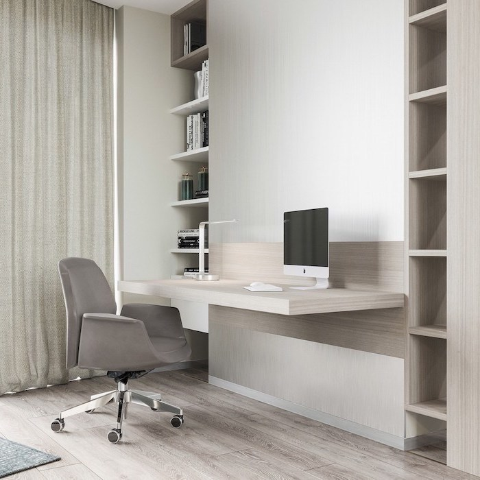 wooden bookshelves, grey velvet chair, wooden desk with a small desk lamp, office ideas, desktop computer