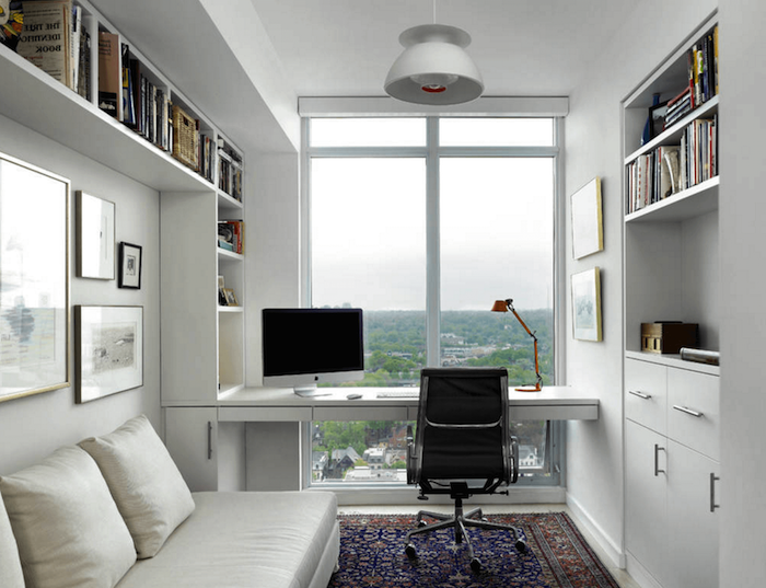 white walls and bookshelves, black leather chair, white leather sofa, office pictures, printed rug