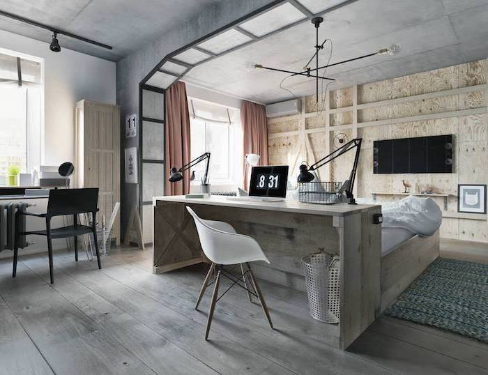 work office decor, wooden wall and desk, white chair, black metal desk lamps