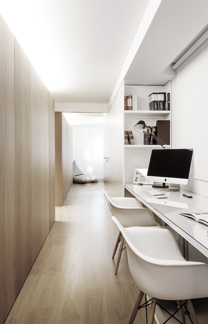 white and wooden walls, two white chairs, white bookshelves, office design, desktop computer