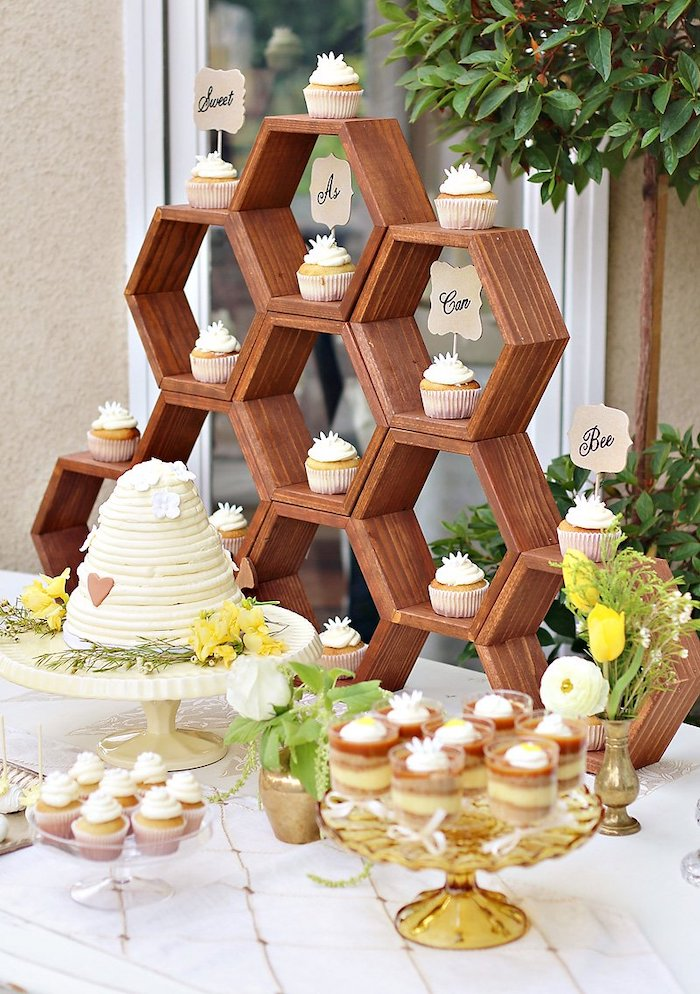 sweet as can bee cupcakes, honeycomb wooden crates, baby shower ideas for boys, cake and cupcakes on the table