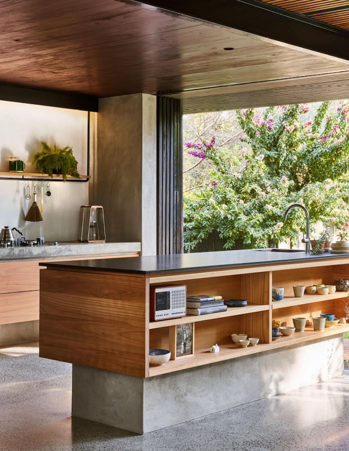 wooden kitchen island drawers and shelves, beautiful kitchens, black counters, grey floor