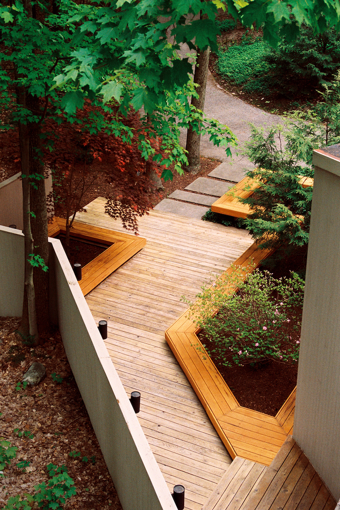 wooden pathway, landscaping ideas for front of house, wooden patches of bushes and tall trees