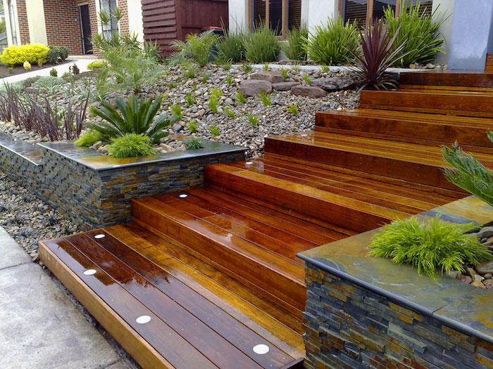wooden staircase, simple front yard landscaping ideas with pictures, patches of rocks grass and bushes
