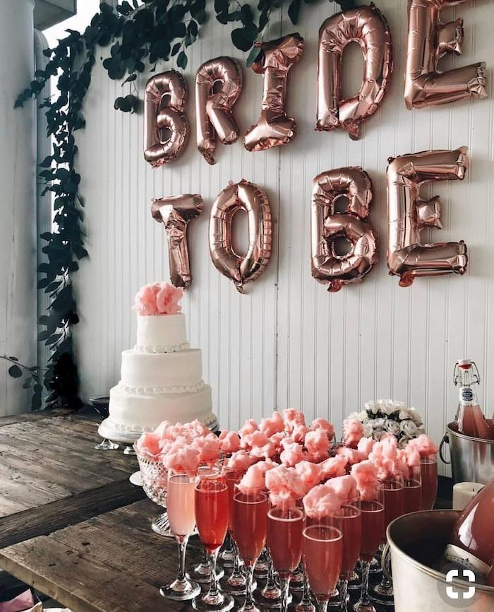bride to be balloons, champagne flutes with cotton candy, fun bachelorette party ideas, three tier cake