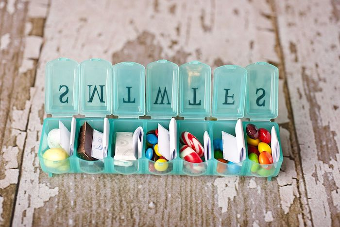 love messages written on a piece of paper, pill box filled with candy, creative valentine's day gifts for boyfriend