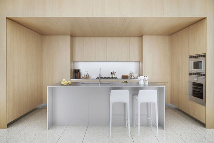 wooden walls and cabinets, grey stainless steel kitchen island, white stools, kitchen island decor