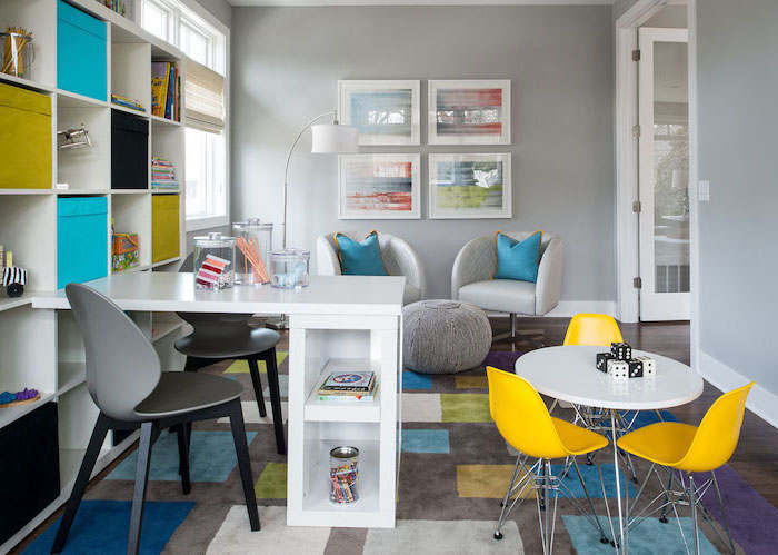 white desk, business office decorating ideas, yellow chairs, blue throw pillows and storage boxes, grey chair