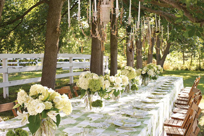 white flower bouquets in vases, hanging candelabrums, wooden chairs, fall wedding ideas