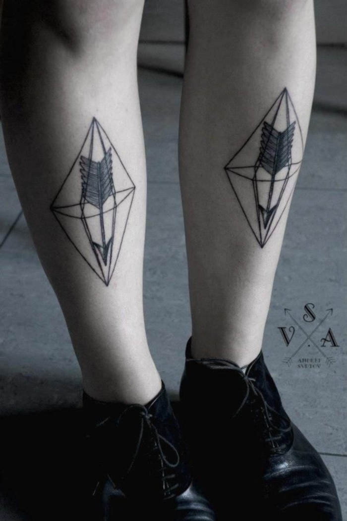 set of feet, flower of life tattoo, triangle and arrow tattoo, on both feet, wearing black shoes