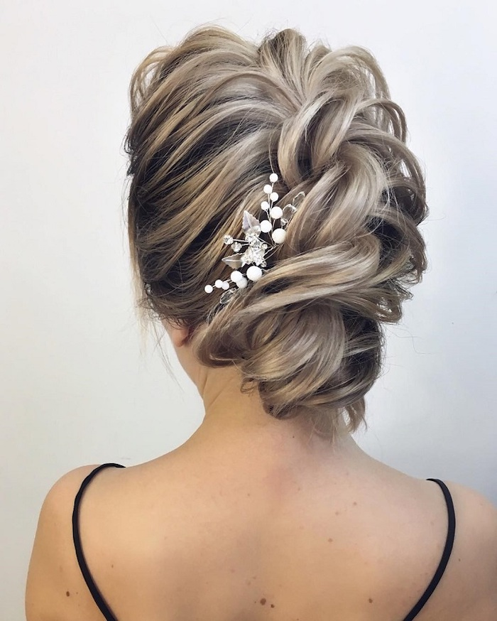 braided platinum blonde hair, in an updo, wedding hairstyle, small pearl hair accessory