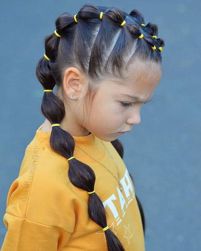 balloon ponytails, yellow rubber bands, braid hairstyles for kids, yellow blouse, blue background