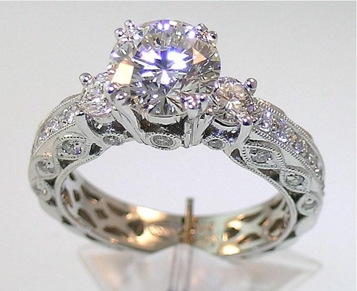 gold engagement rings, large round stone, diamond studded band, white background