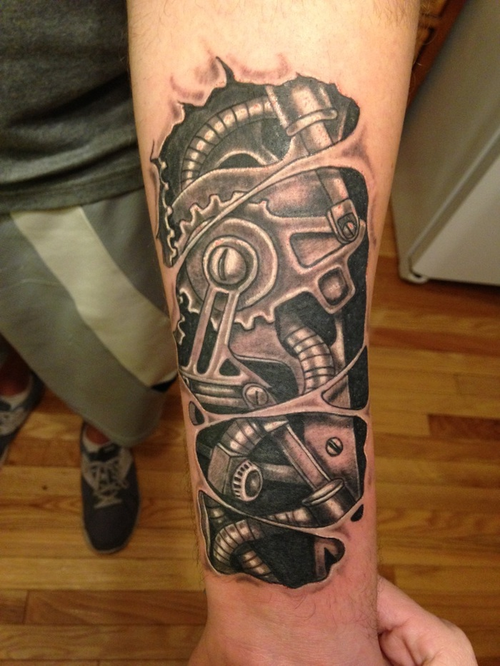 black and white, bio mechanical, forearm tattoo, forearm tattoos for men, wooden floor, grey blouse